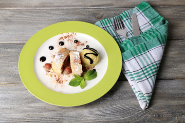 Tasty homemade apple strudel with nuts, mint leaves and