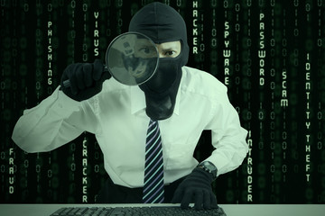 Businessman wearing mask looking for information