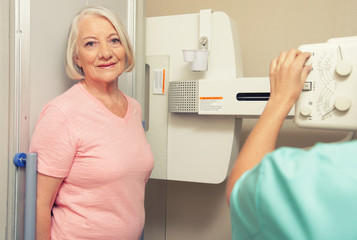 Woman patient ready to be scanned at X-Ray machine