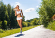 young athletic woman running on the road