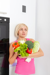 unhappy woman raw fresh vegetables refrigerator