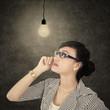 Businesswoman looking the bright bulb 1
