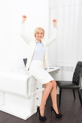 Business woman excited hands up raised arms