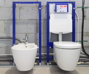 Installation systems for toilets and bidets