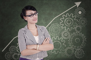 Businesswoman with cogwheel background