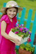 Gardening, planting - girl  working in flowers garden