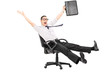 Overjoyed businessman riding in an office chair
