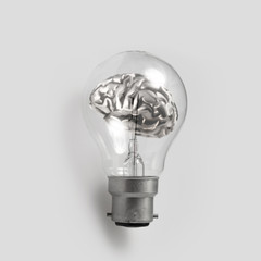 3d metal human brain in a lightbulb as creative concep