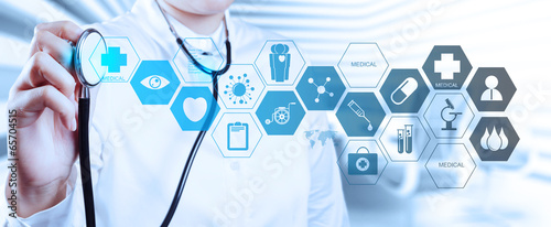 Doctor with a stethoscope in the hands and office background - 65704515