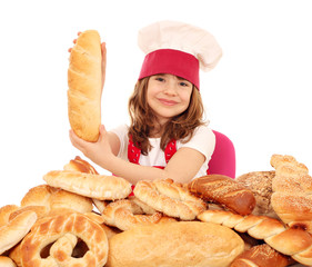 happy little girl cook holding bread