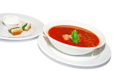 Borsch, red beetroot soup in white plate, menu restaurant