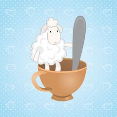 lamb sitting in a cup with a spoon