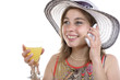 young woman on the phone and drinking a glass