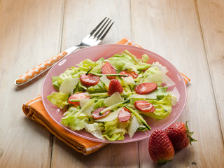 salad with lettuce zucchinis parmesan cheese and strawberries