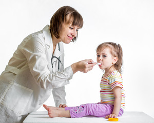 doctor giving medicine to baby girl isolated on white