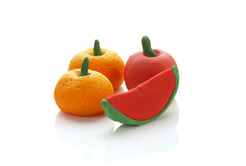 three fruit from clay on white background
