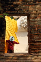 The fabric covers the Buddha statue