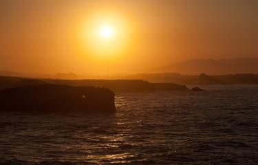 sunset on Playa de las Catedrales during inflow, Spain