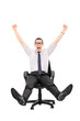 Overjoyed man riding in an office chair