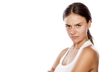 angry young woman without make-up