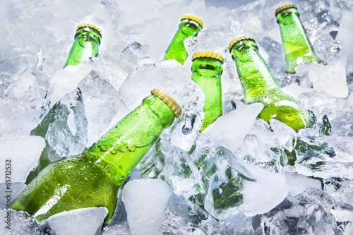 Cold beer bottles on ice - 65712532