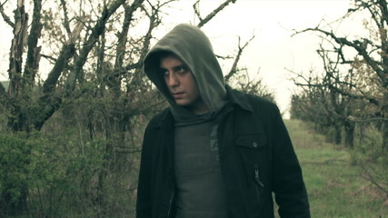 Creepy Dangerous Hooded Man Walking in dark Forest Killer