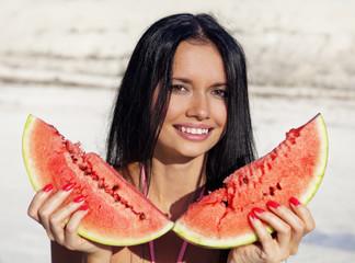 Beautiful girl eats water-melon