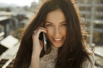 Smiling beautiful woman talking on the Phone.