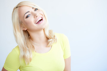 Vivacious young woman laughing at the camera