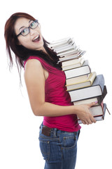 Excited student holding many books