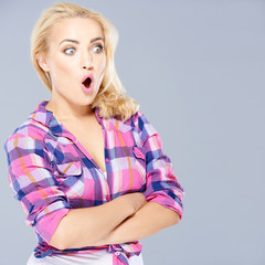 Shocked woman staring open mouthed