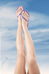 Female legs with flip-flops 1