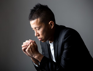 Young man praying to god