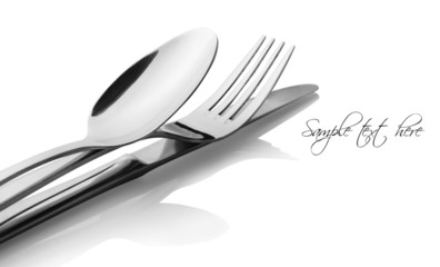 Cutlery - a spoon, fork and knife on a white background