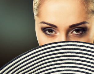 woman eyes behind hat