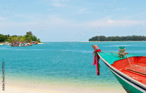 Small boat at white beach