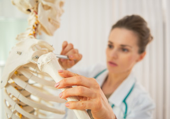 Closeup on medical doctor woman teaching anatomy