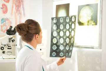 Medical doctor woman looking on tomography