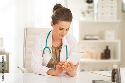 Medical doctor woman using tablet pc