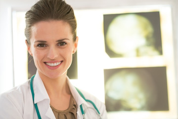 Portrait of medical doctor woman in front of fluorography