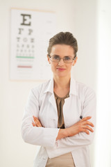 Portrait of ophthalmologist doctor woman