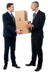 Business men posing with cardboard boxes