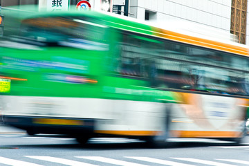 bus speeding with zebra crossing in tokyo on motion
