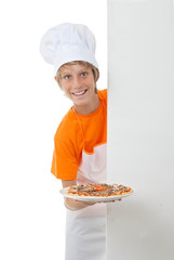 child showing his pizza cooking skills