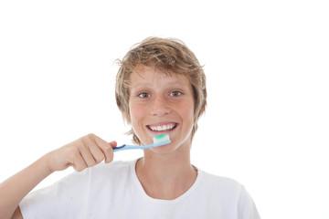 kid or teen cleaning white healthy teeth