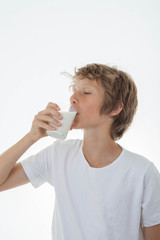 healthy chid drinking glass of milk