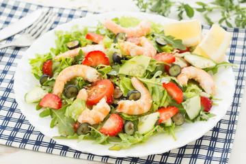 fresh shrimp salad with lettuce; berries, rocket