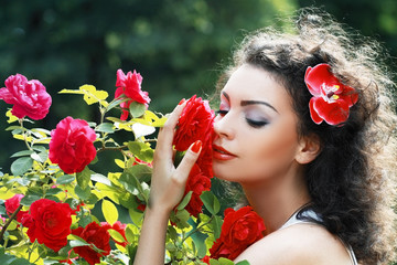 woman smelling red roses