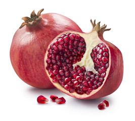 Whole, half and seeds of pomegranate isolated on white backgroun