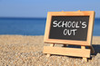 canvas print picture - Blackboard with School's out text on the beach